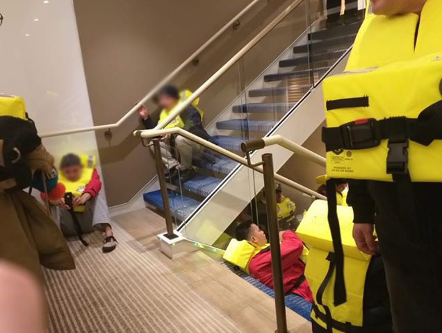 cruise ship crew members with life jackets Viking Sky