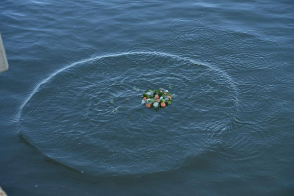 flower ceremony at sea for the sudden death of crew member